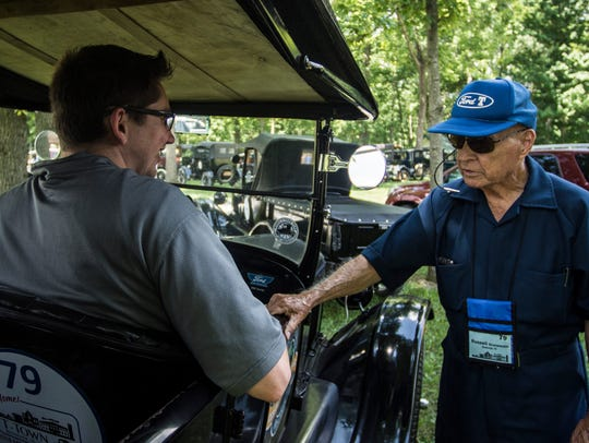 Ford Model T enthusiast Russell Grunewald talks with