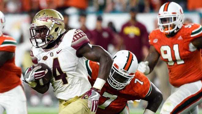 Oct 8, 2016; Miami Gardens, FL, USA; Florida State Seminoles running back Dalvin Cook (4) carries the ball during the first half against Miami Hurricanes at Hard Rock Stadium. Mandatory Credit: Steve Mitchell-USA TODAY Sports