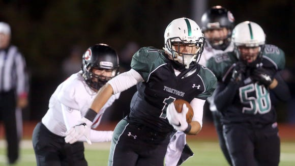 Yorktown's Brett Maker rushes against Rye during a