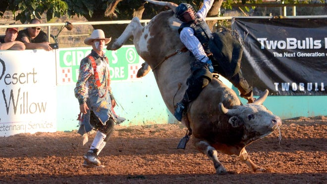 Chon Miranda of Carlsbad steadies himself during the second day of the Dueling in the Desert bull riding competition Saturday at Eddy County Sheriff's Posse Arena.
