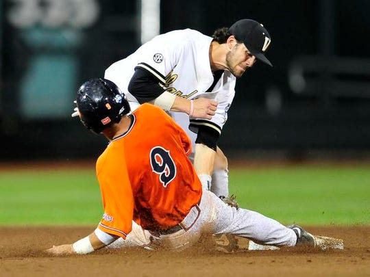 Vanderbilt's Dansby Swanson (7) tags out Virginia's Kenny Towns at second during the 7th inning in the last game of the College World Series at TD Ameritrade Park, Wednesday.