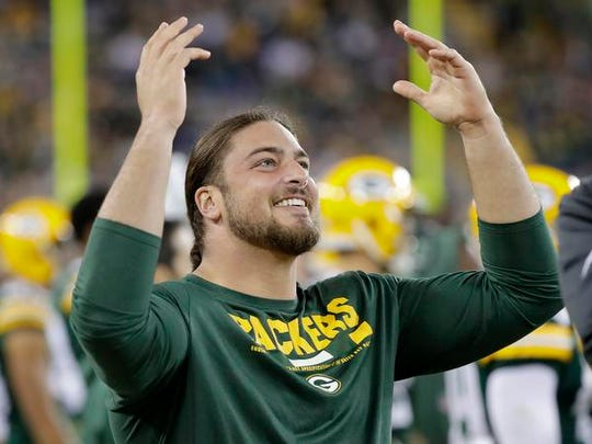 Green Bay Packers tackle David Bakhtiari reacts on the sideline during a game against the Los Angeles Rams in 2017 at Lambeau Field.