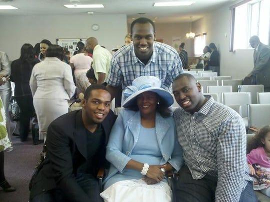"""Camille Jones poses with her sons, Chandler Jones, (top) Jon """"Bones"""" Jones (left) and Arthur Jones (right)."""