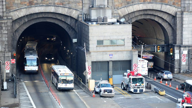 Commuters complain that sections of the Lincoln Tunnel are almost completely dark because of burned-out lights.
