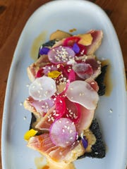 Seared tuna with radish, ponzu and seaweed crackers