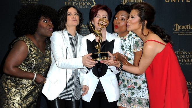 """Sheryl Underwood, from left, Sara Gilbert, Sharon Osbourne, Aisha Tyler, and Julie Chen pose in the pressroom with the award for outstanding talk show entertainment for """"The Talk"""" at the 43rd annual Daytime Emmy Awards at the Westin Bonaventure Hotel on Sunday in Los Angeles."""