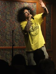 Comedian Johnny Herrera pulls a joke about his weight during the comedy night fundraising event at Miracle Springs Resort and Spa on Sunday.