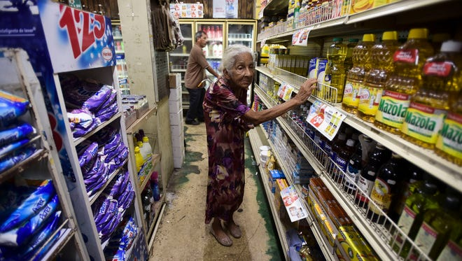 Residents from Juana Matos buy groceries at Catano Mini Market in the middle of a supply shortage caused by Hurricane Maria in Puerto Rico on Sept. 27, 2017.