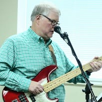 Stroke survivor Lewis Lott performs a guitar solo during a concert Friday, May 20, 2016.