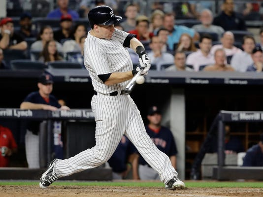 New York Yankees' Todd Frazier hits an RBI single during the eighth inning of the team's baseball game against the Boston Red Sox on Friday, Aug. 11, 2017, in New York. (AP Photo/Frank Franklin II)