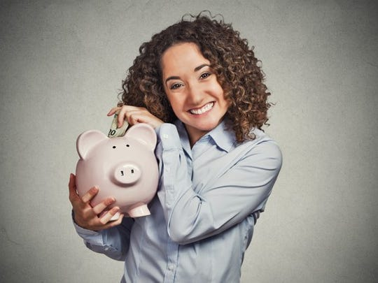 Woman putting money into savings account