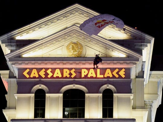 Parachutist descending in front of Caesars Palace in Las Vegas.