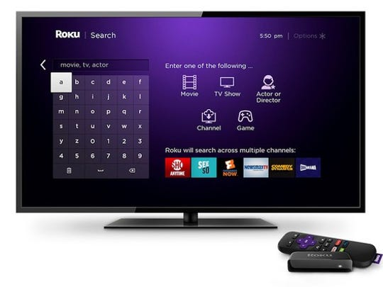 TV displaying Roku's streaming interface displayed on a television with Roku streaming stick nearby