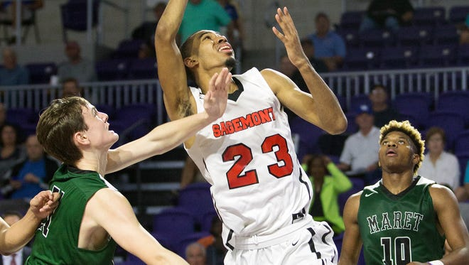 Sagemont School's Tyler Polley scores against Maret during play Saturday (12/17/16) at the Culligan City of Palms Classic at the Suncoast Credit Union Arena in Fort Myers.