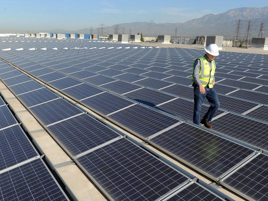 Trump slaps big tariffs on imported solar panels, riling renewables industry