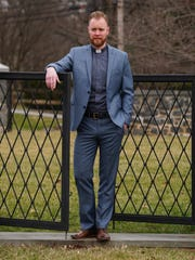 The Rev. Stephen Setzer wears a blue slim-cut suit by Saks Fifth Avenue, clerical shirt with collar by Barbiconi; and brown leather boots by Warfield and Grand from DSW.