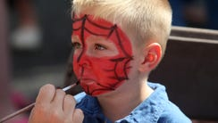 Face-painting is a favorite part of festival fun for