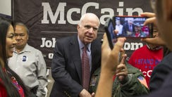 Arizona Sen. John McCain is photographed  with supporters