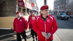 Curtis Sliwa and members of The Guardian Angels, which