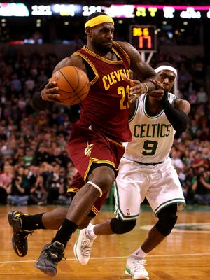 The Cavs' LeBron James  drives to the basket against the Celtics' Rajon Rondo # in the second half at TD Garden on Friday night.