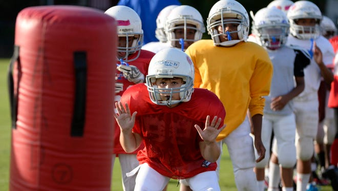 Heads Up Football drill in Alexandria, Va., in 2013.