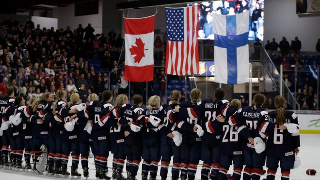 Team USA stands during the national anthem after overtime of the World Championships gold medal game.