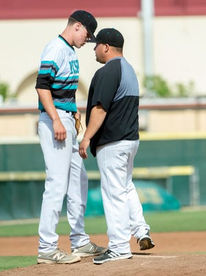 Sheldon coach Matthew McGrew talks to Matt Manning during the third inning as Sheldon takes on Woodcreek High in the Division I playoff game at Sacramento City College on May 19.