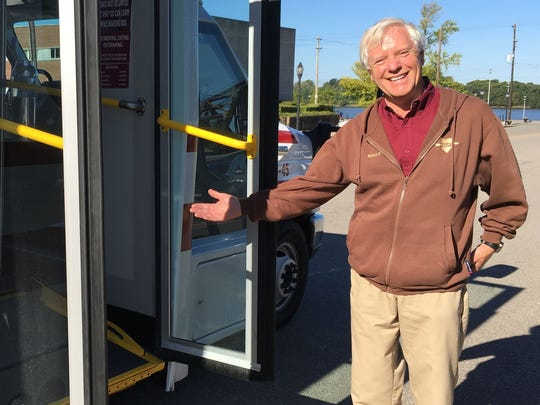Driver Wally Campbell invites passengers onto his bus at the Third and Main street HART transfer station.