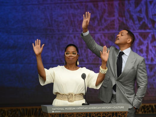 TV celebrity Oprah and actor Will Smith greet the crowd