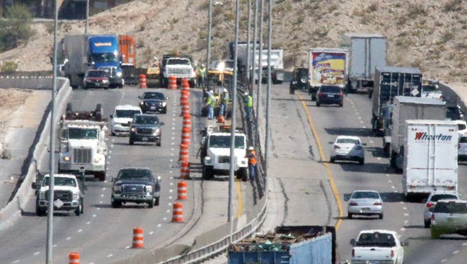 A crew is seen working on the inside shoulder of Interstate 10 East between Sunland Park Drive and Executive Center Boulevard.