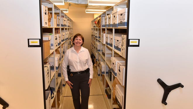 Investigative Sgt. Connie Schuster inside the evidence room at the Door County Sheriff's Department in Sturgeon Bay. The first female officer hired by the department, Schuster will be retiring May 15.