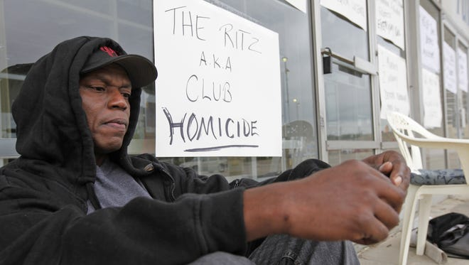 Sitting outside of a closed furniture store in Roselawn May 17, 2010, Ehling Burroughs, father of homicide victim Dexter Burroughs holds vigil a few doors down from Club Ritz where his son was killed. Burroughs vowed to be at the Roselawn strip center every day until the club is shut down.