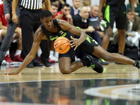 Michigan State Spartans forward Jaren Jackson Jr. (2) dives for a loose ball during the first half of a game against the Indiana Hoosiers at Jack Breslin Student Events Center.