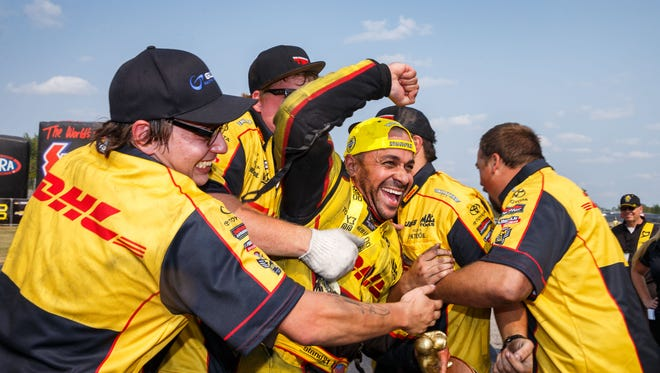 Sep 4, 2017; Clermont, IN, USA; NHRA funny car driver J.R. Todd celebrates with his crew after winning the US Nationals at Lucas Oil Raceway. Mandatory Credit: Mark J. Rebilas-USA TODAY Sports