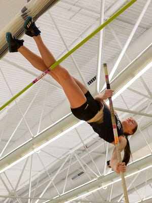 Erica Ellis of Gates-Chili makes an attempt to clear 11 feet in the pole vault.