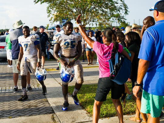 UWF players leave the field and get welcomed by supporters after their inaugural football game on Sept. 3, 2016 in a 45-0 victory against Ave Maria University in Naples.