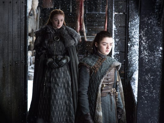Sansa Stark (Sophie Turner), left, and her sister,