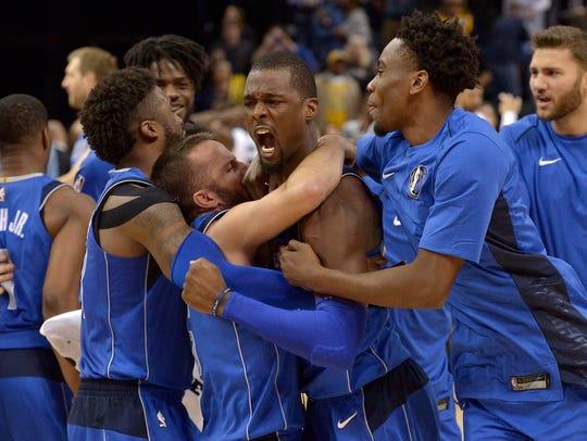 Teammates congratulate Dallas Mavericks forward Harrison