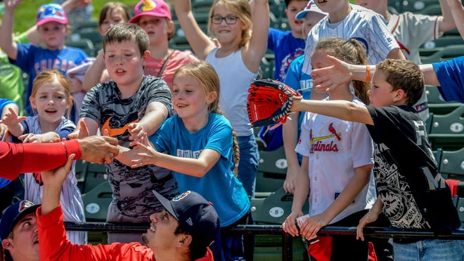 The Peoria Chiefs bullpen hands out baseballs to kids during Education Day on Wednesday, May 15, 2019 at Dozer Park in Peoria.