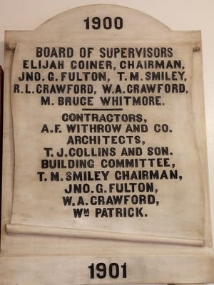 This marble plaque honoring those who made the courthouse possible still hangs on the wall of the courthouse today.