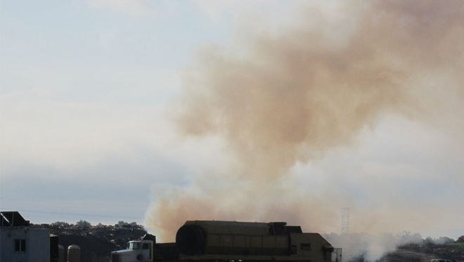 Smoke rises from a fire at Rolling Hills landfill Friday morning.