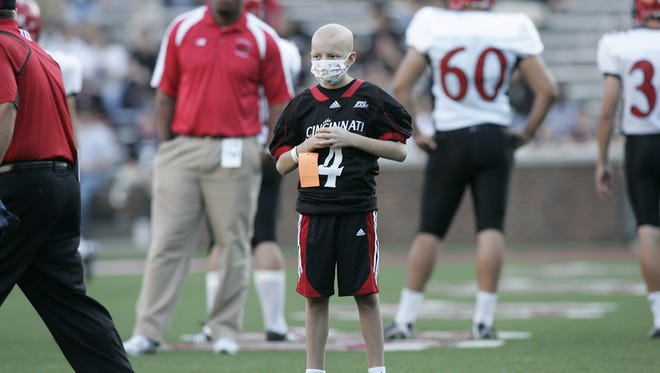 Mitch Stone, the young man who has been adopted as the little brother of the UC football team.      His story will run over the Thanksgiving holiday.