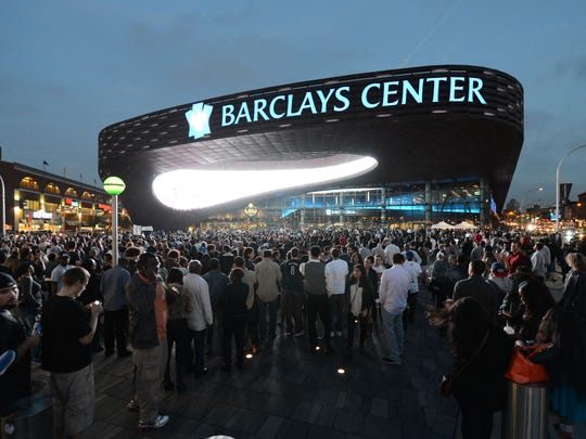 FILE - This Sept. 28, 2012 file photo shows people arriving for the first of eight Jay-Z shows at the Barclays Center in the Brooklyn borough of New York.
