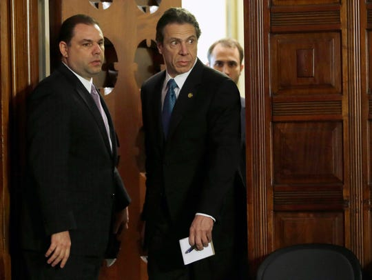 FILE - In this April 26, 2013, file photo, New York Gov. Andrew Cuomo, right, and Joseph Percoco, executive deputy secretary, stand at a news conference in Albany, N.Y.