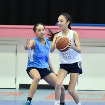 With the graduation of All-Island player Joylyn Pangilinan, the future of the St. Paul Warriors basketball program could lay in the hands of Chloe Miranda (white) and teammate Haley Senne who both play for the U18 Guam national girls basketball team.