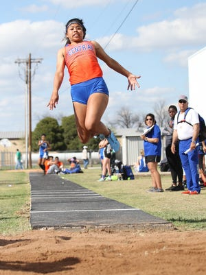 Central High School's Anastasia Candela competes in the girls long jump March 29, 2018, at the Cotton Patch Relays in Wall.