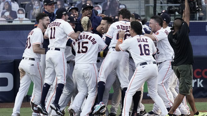 Houston players celebrate Carlos Correa's walk off home run during the ninth inning in Game 5 of Thursday's game.
