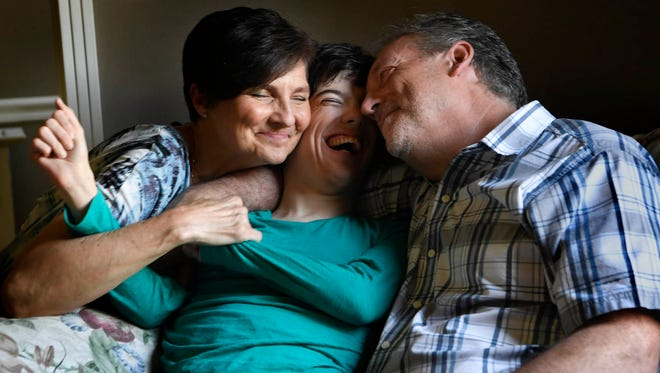 Kelli and Craig Campbell care for their twenty nine year old daughter Samantha, who has cerebral palsy at their home in Franklin, Tenn., Monday, May 7, 2018.