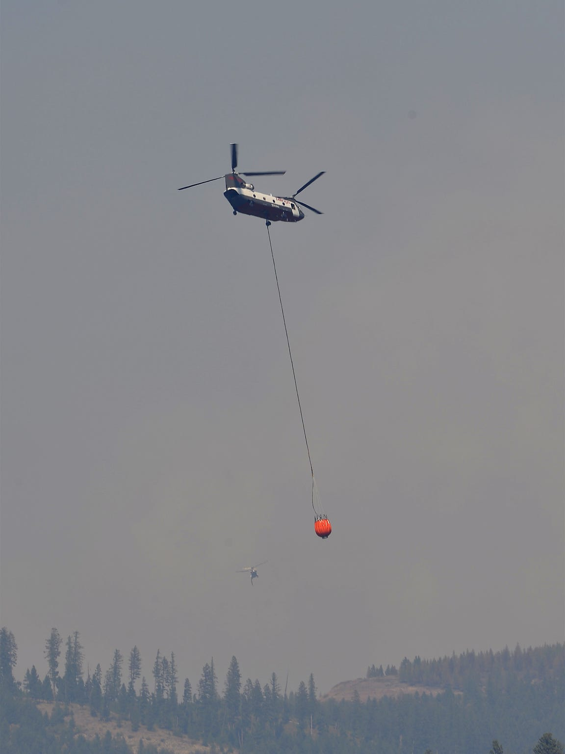 The Rice Ridge Fire continues to threaten the town of Seeley Lake as it burns in the Lolo National Forest, Friday.