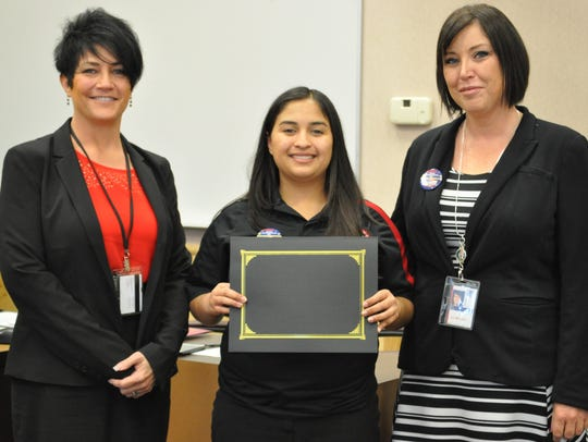 Emily Stubbs-Ponce received an award for trainer of
